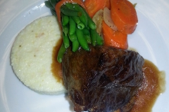 Braised Short Rib with creamy grits and haricot vert bundle
