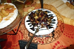 Brie topped with dried fruits and balsamic glaze