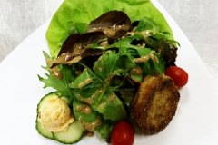 Plated Salad with fried green tomato and pimento cheese