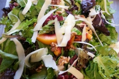 Fall salad with grilled peaches and shaved manchego